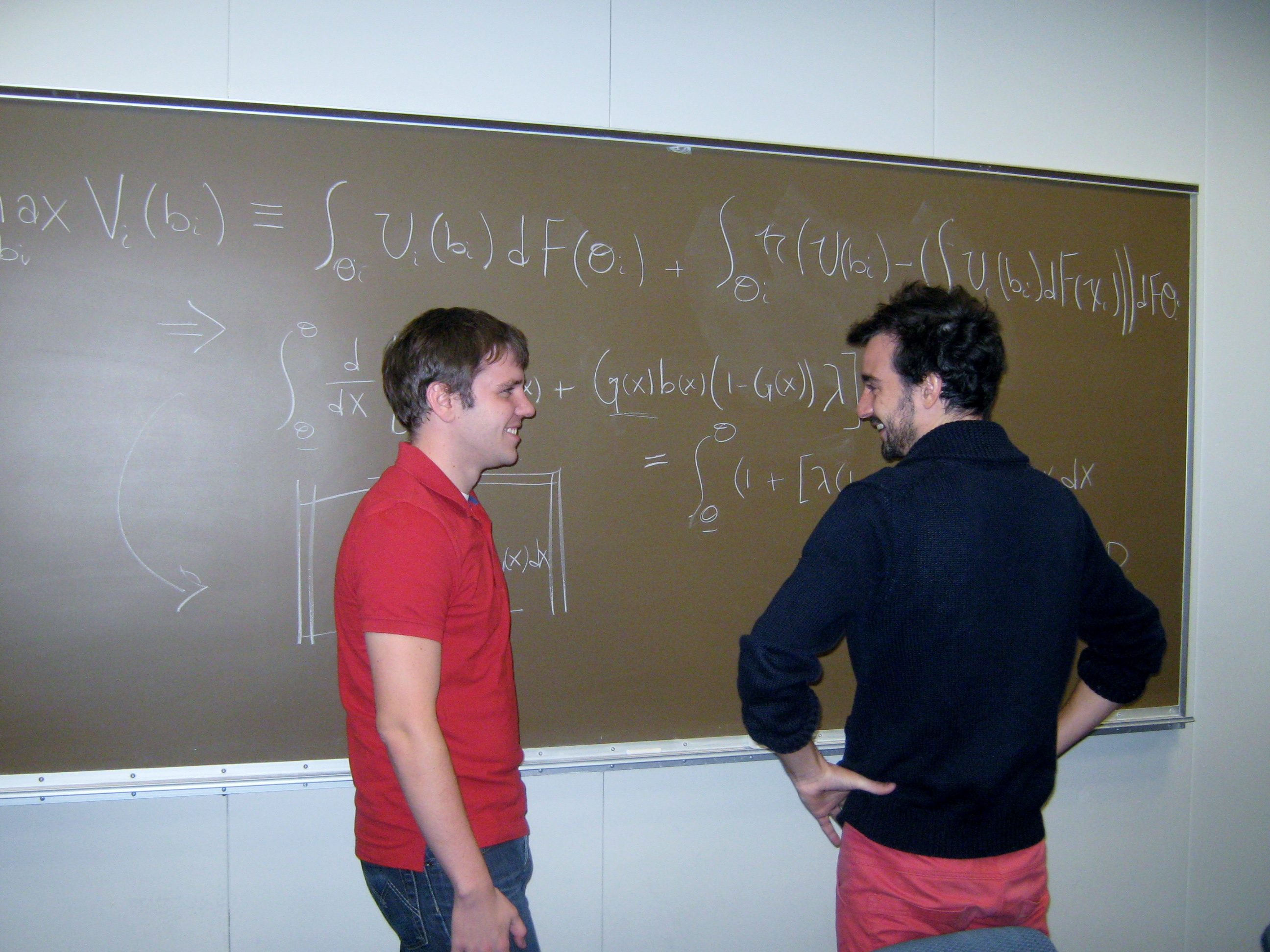 "Evan Piermont and Ricky Svoboda, fourth-year graduate students, working on their joint research project ""Endogenous Reference Dependent Preferences in Sealed Bid Auctions"" – November, 2014"